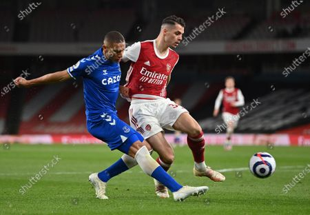 Everton's Richarlison, left, duels for the ball with Arsenal's Granit Xhaka during the English Premier League soccer match between Arsenal and Everton at the Emirates stadium in London