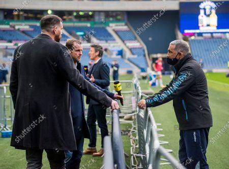 Stock Photo of Edinburgh vs Zebre. Zebre head coach Michael Bradley chats with Premier Sports' Jim Hamilton and Chris Paterson before the game