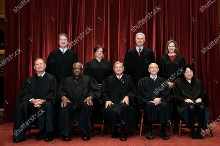 Members of the Supreme Court pose for a group photo at the Supreme Court in Washington, DC on Friday, April 23, 2021. Seated from left: Associate Justice Samuel Alito, Associate Justice Clarence Thomas, Chief Justice John Roberts, Associate Justice Stephen Breyer and Associate Justice Sonia Sotomayor, Standing from left: Associate Justice Brett Kavanaugh, Associate Justice Elena Kagan, Associate Justice Neil Gorsuch and Associate Justice Amy Coney Barrett.