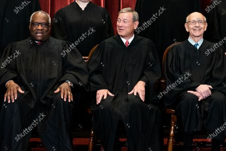 Members of the Supreme Court pose for a group photo at the Supreme Court in Washington, DC on Friday, April 23, 2021. SAssociate Justice Clarence Thomas, Chief Justice John Roberts, Associate Justice Stephen Breyer    Pool photo by Erin Schaff/UPI