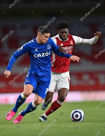 Thomas Partey (R) of Arsenal in action against James Rodriguez of Everton during the English Premier League soccer match between Arsenal FC and Everton FC in London, Britain, 23 April 2021.