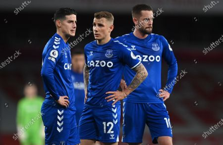 James Rodriguez (L), Lucas Digne (C) and Gylfi Sigurdsson (R) of Everton react during the English Premier League soccer match between Arsenal FC and Everton FC in London, Britain, 23 April 2021.