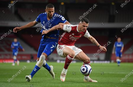 Granit Xhaka (R) of Arsenal in action against Bukayo Saka of Everton during the English Premier League soccer match between Arsenal FC and Everton FC in London, Britain, 23 April 2021.