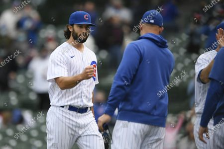 Chicago Cubs closing pitcher Dillon Maples left, celebrates with manager David Ross right, after defeating the Milwaukee Brewers in a baseball game, in Chicago