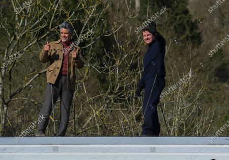 Stock Image of Tom Cruise alongside Esai Morales waves from a train during the filming of Mission Impossible 7 in Levisham, North Yorkshire