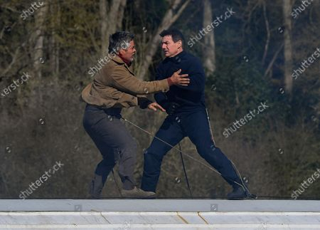 Stock Picture of Tom Cruise and Esai Morales act a fight scene on the roof of a train during the filming of Mission Impossible 7 in Levisham, North Yorkshire