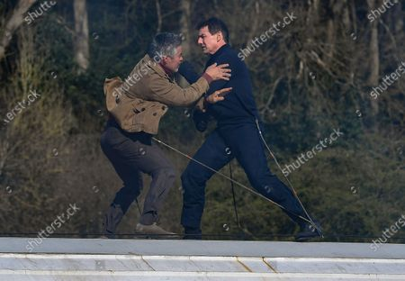 Stock Photo of Tom Cruise and Esai Morales act a fight scene on the roof of a train during the filming of Mission Impossible 7 in Levisham, North Yorkshire