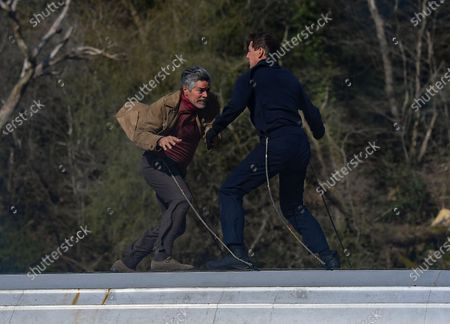 Tom Cruise and Esai Morales act a fight scene on the roof of a train during the filming of Mission Impossible 7 in Levisham, North Yorkshire