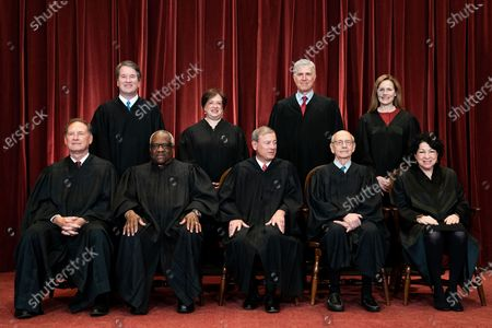 Stock Photo of Members of the Supreme Court pose for a group photo at the Supreme Court in Washington, DC. Seated from left: Associate Justice of the Supreme Court Samuel A. Alito, Jr., Associate Justice of the Supreme Court Clarence Thomas, Chief Justice of the United States John G. Roberts, Jr., Associate Justice of the Supreme Court Stephen G. Breyer, and Associate Justice of the Supreme Court Sonia Sotomayor, Standing from left: Associate Justice of the Supreme Court Brett Kavanaugh, Associate Justice of the Supreme Court Elena Kagan, Associate Justice of the Supreme Court Neil M. Gorsuch and Associate Justice of the Supreme Court Amy Coney Barrett.