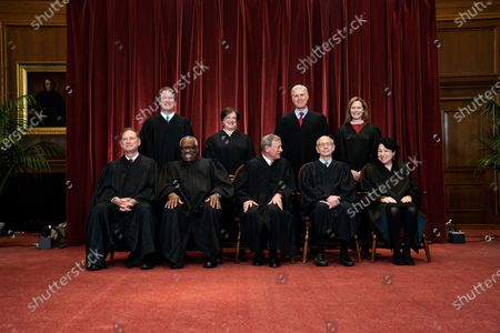 Stock Image of Members of the Supreme Court pose for a group photo at the Supreme Court in Washington, DC. Seated from left: Associate Justice of the Supreme Court Samuel A. Alito, Jr., Associate Justice of the Supreme Court Clarence Thomas, Chief Justice of the United States John G. Roberts, Jr., Associate Justice of the Supreme Court Stephen G. Breyer, and Associate Justice of the Supreme Court Sonia Sotomayor, Standing from left: Associate Justice of the Supreme Court Brett Kavanaugh, Associate Justice of the Supreme Court Elena Kagan, Associate Justice of the Supreme Court Neil M. Gorsuch and Associate Justice of the Supreme Court Amy Coney Barrett.