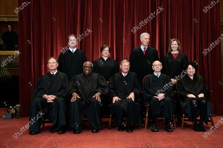 Stock Picture of Members of the Supreme Court pose for a group photo at the Supreme Court in Washington, DC. Seated from left: Associate Justice of the Supreme Court Samuel A. Alito, Jr., Associate Justice of the Supreme Court Clarence Thomas, Chief Justice of the United States John G. Roberts, Jr., Associate Justice of the Supreme Court Stephen G. Breyer, and Associate Justice of the Supreme Court Sonia Sotomayor, Standing from left: Associate Justice of the Supreme Court Brett Kavanaugh, Associate Justice of the Supreme Court Elena Kagan, Associate Justice of the Supreme Court Neil M. Gorsuch and Associate Justice of the Supreme Court Amy Coney Barrett.