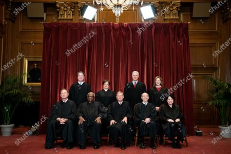 Members of the Supreme Court pose for a group photo at the Supreme Court in Washington, DC. Seated from left: Associate Justice of the Supreme Court Samuel A. Alito, Jr., Associate Justice of the Supreme Court Clarence Thomas, Chief Justice of the United States John G. Roberts, Jr., Associate Justice of the Supreme Court Stephen G. Breyer, and Associate Justice of the Supreme Court Sonia Sotomayor, Standing from left: Associate Justice of the Supreme Court Brett Kavanaugh, Associate Justice of the Supreme Court Elena Kagan, Associate Justice of the Supreme Court Neil M. Gorsuch and Associate Justice of the Supreme Court Amy Coney Barrett.
