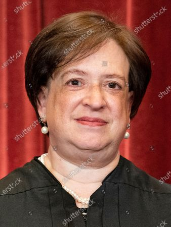 Associate Justice of the Supreme Court Elena Kagan stands during a group photo of the Justices at the Supreme Court in Washington, DC.
