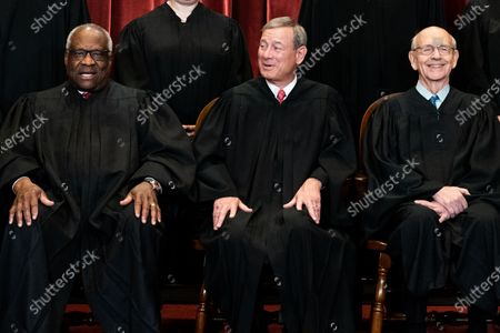 Members of the Supreme Court pose for a group photo at the Supreme Court in Washington, DC. Seated from left: Associate Justice of the Supreme Court Clarence Thomas, Chief Justice of the United States John G. Roberts, Jr. and Associate Justice of the Supreme Court Stephen G. Breyer.