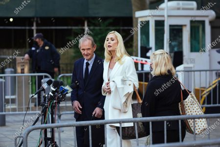 Attorneys David Boies, left, and Sigrid McCawley speak following Ghislaine Maxwell's appearance in Federal Court, in New York. Ghislaine Maxwell, a British socialite and one-time girlfriend of Epstein, pleaded not guilty to sex trafficking conspiracy and an additional sex trafficking charge that were added in a rewritten indictment released last month by a Manhattan federal court grand jury