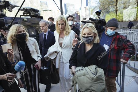 Accuser Danielle Bensky, at right, departs following Ghislaine Maxwell's appearance in Federal Court, in New York. Ghislaine Maxwell, a British socialite and one-time girlfriend of Epstein, pleaded not guilty to sex trafficking conspiracy and an additional sex trafficking charge that were added in a rewritten indictment released last month by a Manhattan federal court grand jury