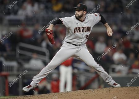 Stock Photo of Arizona Diamondbacks pitcher Alex Young works against the Atlanta Braves in the eighth inning of a baseball game, in Atlanta