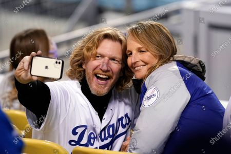 Actress Helen Hunt poses for a picture with Steven Tepper during a baseball game between the Los Angeles Dodgers and the San Diego Padres, in Los Angeles