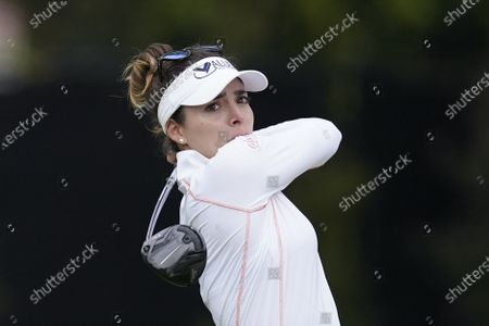 Stock Photo of Gaby Lopez tees off at the fifth hole during the third round of the LPGA's Hugel-Air Premia LA Open golf tournament at Wilshire Country Club, in Los Angeles