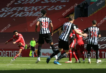 Trent Alexander-Arnold of Liverpool takes a direct free kick on goal; Anfield, Liverpool, Merseyside, England; English Premier League Football, Liverpool versus Newcastle United.