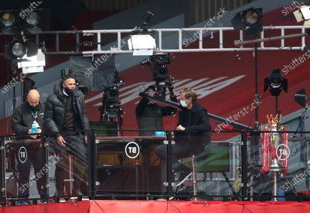 BT Sport pundits Jermaine Jenas and Peter Crouch with the Premier League trophy; Anfield, Liverpool, Merseyside, England; English Premier League Football, Liverpool versus Newcastle United.