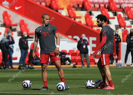Thiago Alcantara of Liverpool speaks with team mate Mohammed Salah of Liverpool during the pre match warm up; Anfield, Liverpool, Merseyside, England; English Premier League Football, Liverpool versus Newcastle United.