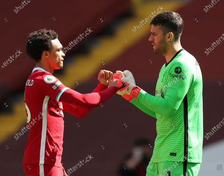Trent Alexander-Arnold of Liverpool fist bumps goalkeeper Alisson Becker; Anfield, Liverpool, Merseyside, England; English Premier League Football, Liverpool versus Newcastle United.