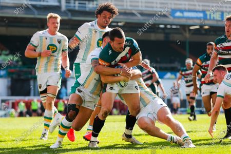 Matt Scott of Leicester Tigers is driven towards the touchline by the Northampton Saints defence; Mattoli Woods Welford Road Stadium, Leicester, Midlands, England; Gallagher Premiership Rugby, Leicester Tigers versus Northampton Saints.