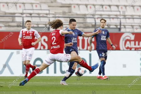 Florian Thauvin of OM and Wout Faes of Reims