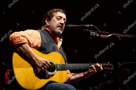 Stock Photo of Portuguese singer Rui Veloso participates in the first concert, after the 3 reopening phase due to the covid-19, held at the Superbock Arena, on April 23, 2021, in Porto, Portugal.