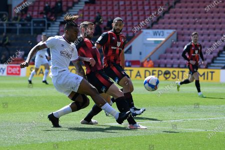 Ivan Toney of Brentford left has a shot on goal blocked by Steve Cook of AFC Bournemouth during AFC Bournemouth vs Brentford, Sky Bet EFL Championship Football at the Vitality Stadium on 24th April 2021