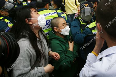 University student protesters try to go Japanese embassy as Police officials block in a protest against Japan's decision to release radioactive water from the Fukushima Nuclear Power Plant into the ocean, outside the Japanese embassy in Seoul, South Korea, 24 April 2021. On 13 April, the Japanese government decided to discharge radioactive water from the crippled Fukushima nuclear plant into the Pacific Ocean.