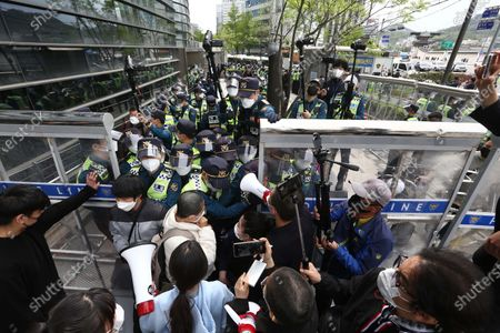 University student protesters (front) try to go Japanese embassy as Police officials block in a protest against Japan's decision to release radioactive water from the Fukushima Nuclear Power Plant into the ocean, outside the Japanese embassy in Seoul, South Korea, 24 April 2021. On 13 April, the Japanese government decided to discharge radioactive water from the crippled Fukushima nuclear plant into the Pacific Ocean.