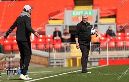 Newcastle's head coach Steve Bruce, right, stands during the English Premier League soccer match between Liverpool and Newcastle United at Anfield stadium in Liverpool, England