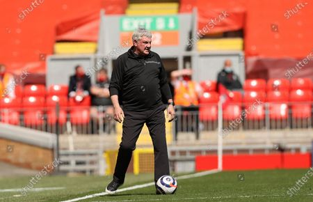 Newcastle's head coach Steve Bruce stands during the English Premier League soccer match between Liverpool and Newcastle United at Anfield stadium in Liverpool, England