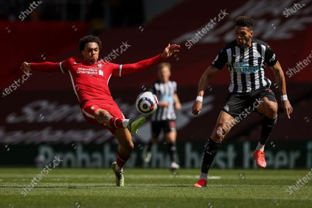 Trent Alexander-Arnold (L) of Liverpool in action against Joelinton (R) of Newcastle during the English Premier League soccer match between Liverpool FC and Newcastle United in Liverpool, Britain, 24 April 2021.