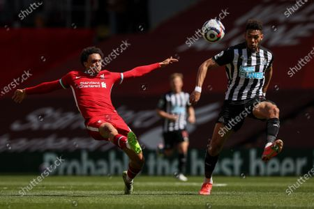Stock Image of Trent Alexander-Arnold (L) of Liverpool in action against Joelinton (R) of Newcastle during the English Premier League soccer match between Liverpool FC and Newcastle United in Liverpool, Britain, 24 April 2021.