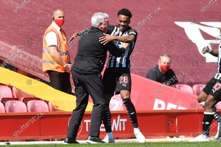 Joseph Willock (R) celebrates with Newcastle manager Steve Bruce after scoring a goal during the English Premier League soccer match between Liverpool FC and Newcastle United in Liverpool, Britain, 24 April 2021.