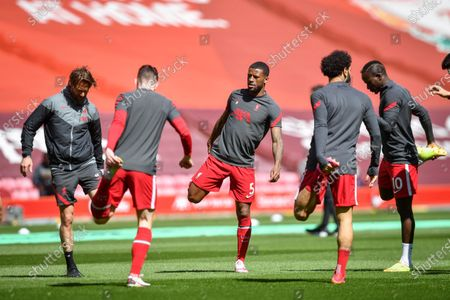 Liverpool's Georginio Wijnaldum (C) warms up  ahead of the English Premier League soccer match between Liverpool FC and Newcastle United in Liverpool, Britain, 24 April 2021.