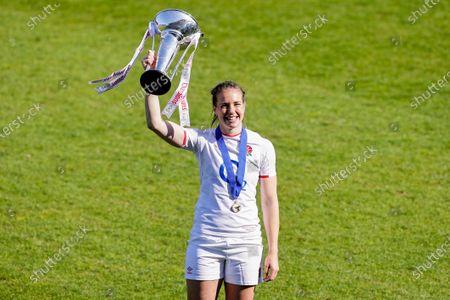 England Women vs France Women. England's Emily Scarratt celebrates with the trophy