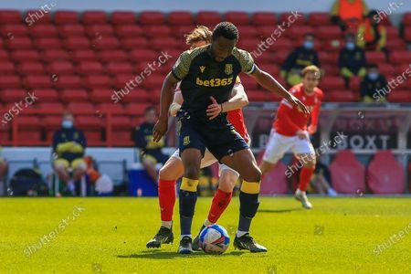 Mikel John Obi (13) Stoke City  is tackled by James Garner (37) of Nottingham Forest during the EFL Sky Bet Championship match between Nottingham Forest and Stoke City at the City Ground, Nottingham