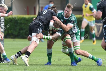 Benetton Rugby vs Glasgow Warriors. Glasgow's Ryan Wilson tackled by Niccolo Cannone and Federico Ruzza of Benetton