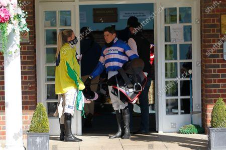 Champion jockey Harry Skelton and partner Bridget Andrews outside the weighing room at Sandown.