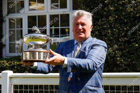 Paul Nicholls celebrates his 2020-2021 National Hunt Trainers Championship at Sandown.