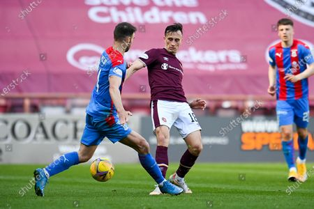Stock Photo of Sean Walsh (#4) of Inverness Caledonian Thistle FC tackles Aaron McEneff (#18) of Heart of Midlothian FC during the SPFL Championship match between Heart of Midlothian and Inverness CT at Tynecastle Park