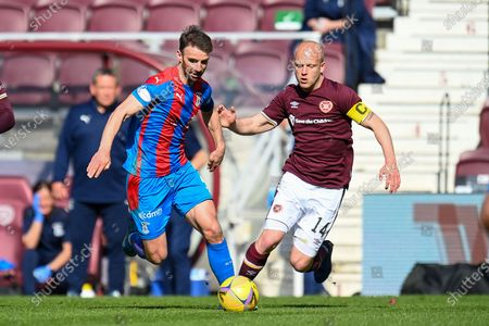 Sean Walsh (#4) of Inverness Caledonian Thistle FC and Steven Naismith (#14) of Heart of Midlothian FC during the SPFL Championship match between Heart of Midlothian and Inverness CT at Tynecastle Park
