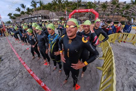 Jan Frodeno (C) of Germany waits for the start  of the Triathlon Challenge race held in Mogan, Gran Canaria, Canary Islands, Spain, 24 April 2021, the first one held in Europe after the coronavirus pandemic started.
