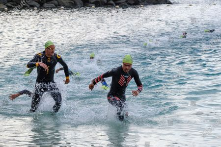 Jan Frodeno (L) of Germany competes in the Triathlon Challenge race held in Mogan, Gran Canaria, Canary Islands, Spain, 24 April 2021, the first one held in Europe after the coronavirus pandemic started.