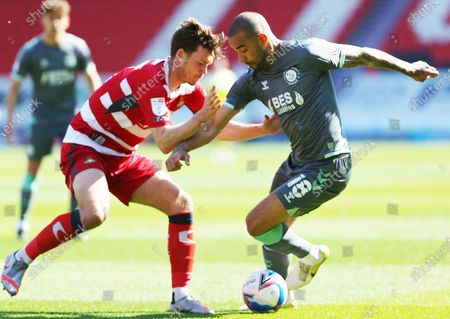 Kyle Vassell of Fleetwood Town (18)  takes on Doncaster defender Joe Wright (5 during the EFL Sky Bet League 1 match between Doncaster Rovers and Fleetwood Town at the Keepmoat Stadium, Doncaster