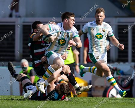 Tommy Freeman of Northampton Saints is halted in his tracks by Matt Scott of Leicester Tigers and Cyle Brink of Leicester Tigers
